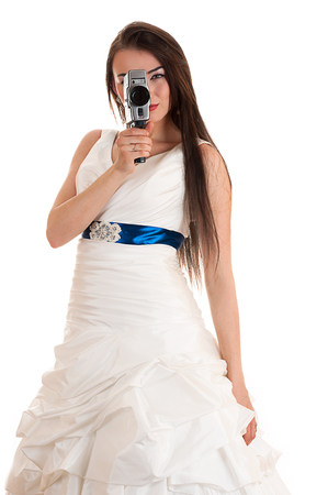 woman in a wedding dress with the old Soviet video camera photo