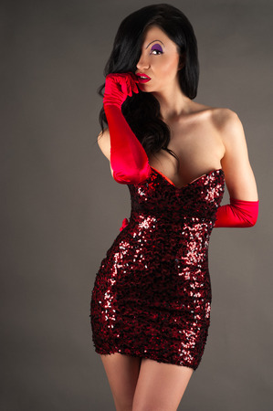 sequins: woman in a red dress with sequins Stock Photo