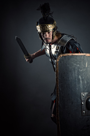legionary: brutal Roman legionary with sword and shield in hands