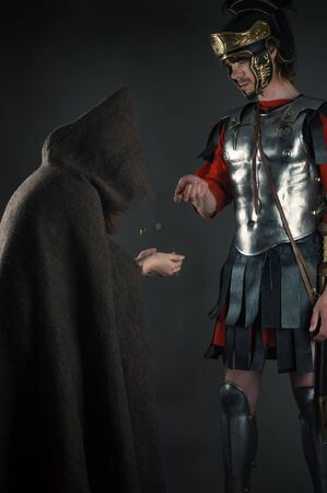 legionary: Roman legionary gives a beggar a coin Stock Photo