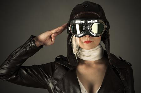 aviator: woman pilot saluting Stock Photo