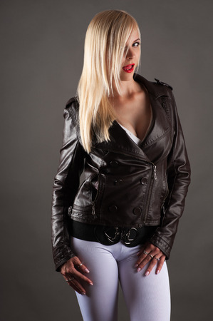 lustful: beautiful sexy woman in a jacket licking lips