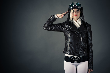 woman with aviator helmet saluting