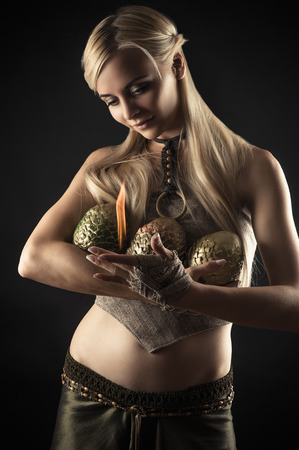 warms: beautiful woman warms fire dragon eggs