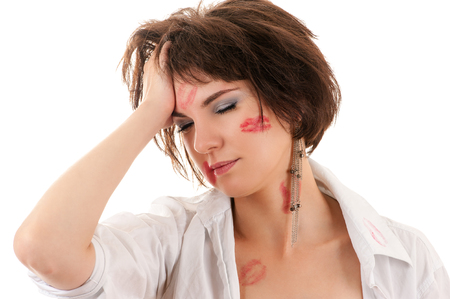 kissing lips: drunken woman holding a hand behind his head Stock Photo
