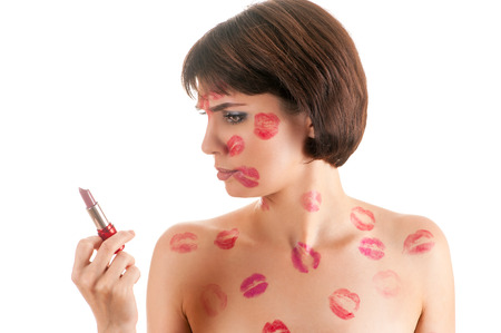 kissing lips: attractive woman with lipstick in hand kissing