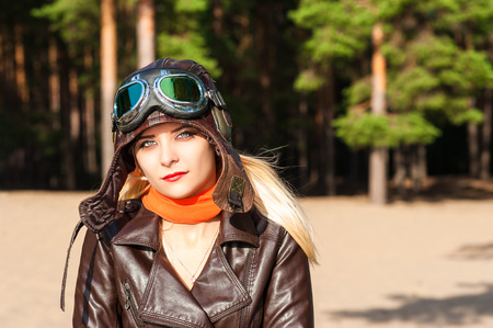 pilot helmet: portrait of a woman in helmet of the pilot on a sunny day