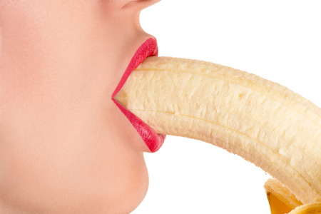 beautiful sexy female lips with a banana Stock Photo