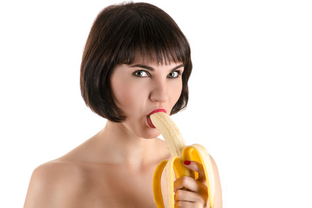 sucking: fashion sexy woman eating banana Stock Photo