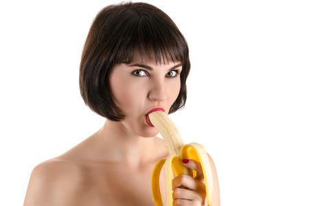 comiendo platano: moda mujer sexy comer pl�tano Foto de archivo
