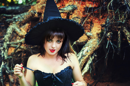sexy witch: witch sexy woman licking lips Stock Photo