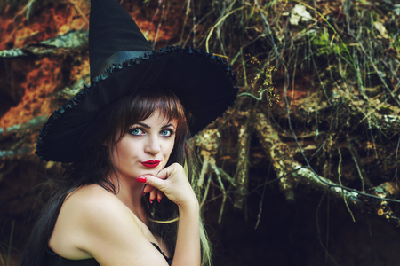beautiful woman in a witch hat