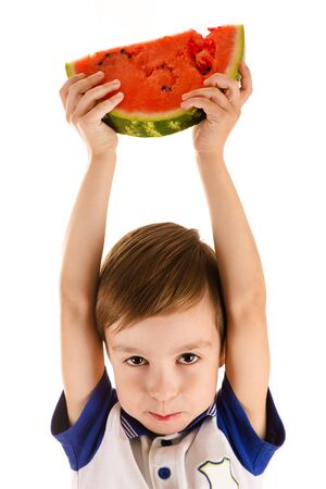 to white: boy holding a watermelon on head Stock Photo