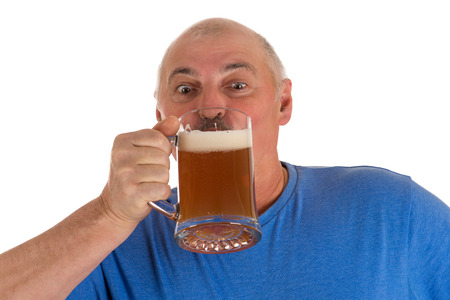 gray haired man drinking beer