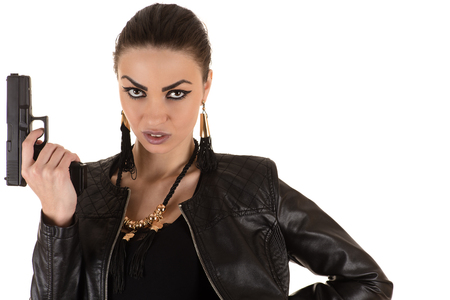 girl models: dangerous woman in bodysuit with gun in hand