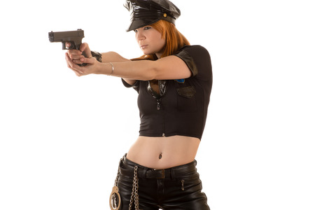 femme policier: sexy de police visant un pistolet