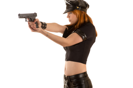 police woman aiming a pistol Stock Photo