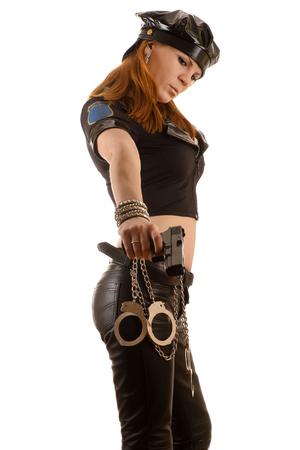 bdsm handcuff: beautiful woman aiming a gun down Stock Photo