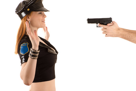 police woman with hands up gesture Stock Photo