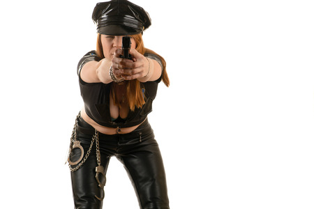 aiming: police woman aiming a gun Stock Photo