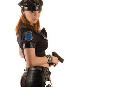 bdsm handcuff: charming police woman with gun in hand Stock Photo