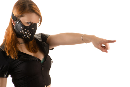 slave: slave police woman in mask with spikes Stock Photo