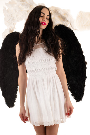 angel hair: beautiful woman with black wings Stock Photo