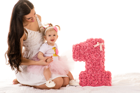 one child: young brunette woman with a small daughter Stock Photo