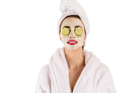 red bathrobe: beautiful woman with a mask on the face wellness Stock Photo