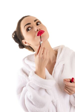 red bathrobe: brunette woman in bathrobe with red lipstick