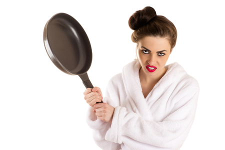 red bathrobe: woman with a frying pan in a hand in white bathrobe