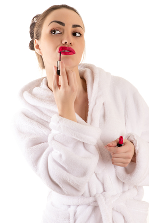 red bathrobe: beautiful brunette woman in bathrobe with red lipstick