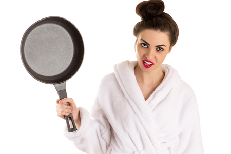 red bathrobe: beautiful woman with a frying pan in a hand in white bathrobe Stock Photo