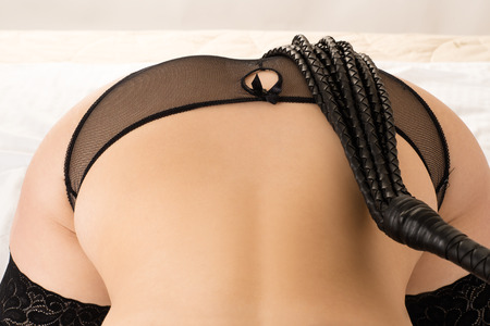 bdsm: beautiful ass with a whip