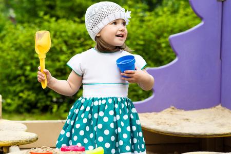 sandbox: little girl playing in the sandbox