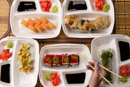 japanese cookery: assorted sushi and rolls on the table, top view