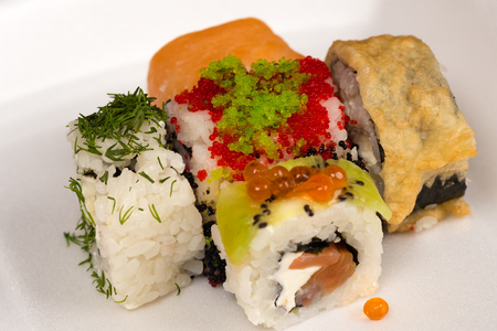 japanese cookery: five different delicious rolls closeup