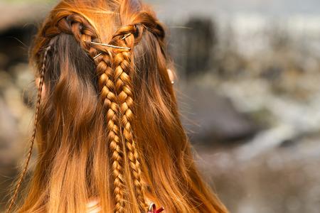 barrettes: beautiful braid hairstyle on redhead woman