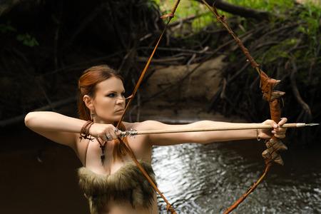 female archer shoots a bow