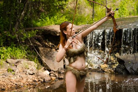 archer shoots a bow Stock Photo