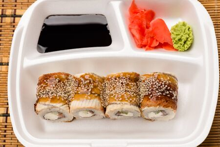 japanese cookery: sushi rolls in white plate view from above Stock Photo