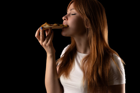 attractive young girl eating pizza