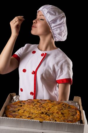 gesticulation: young girl chef enjoying pizza smell