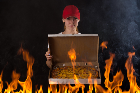 pizza box: young girl with pizza box on fire
