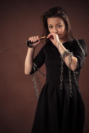 korean girl: brutal korean girl with sword Stock Photo
