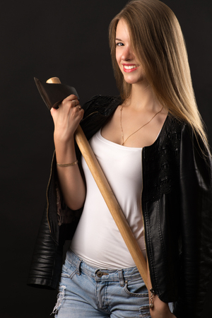 smiling blond teenager with ax in hands