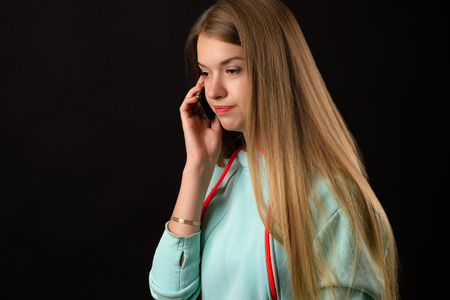 dissatisfied: dissatisfied teenager girl talking on mobile phone