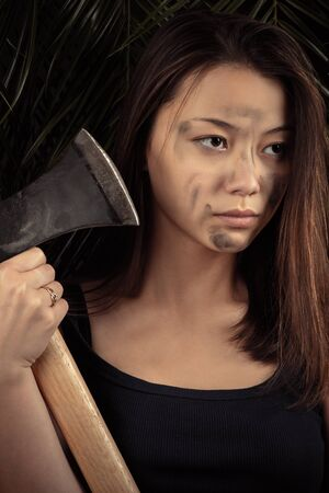 beautiful Korean girl with ax in hands Stock Photo