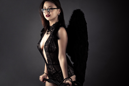 Sexy Korean Girl With Whip In Hands With Black Wings Stock Photo 75523886