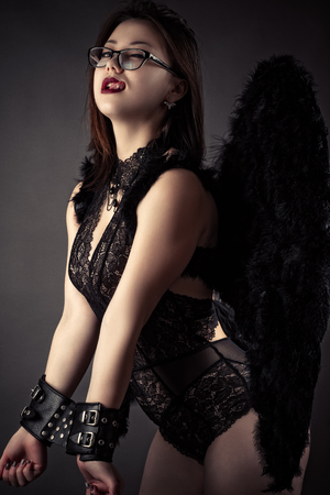 seductive woman with handcuffs devil wings